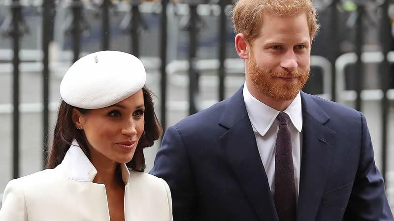 Prince Harry checking pregnant Meghan Markle